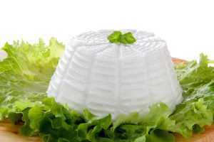 Ricotta cheese on green salad